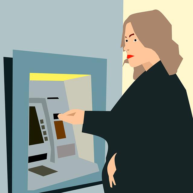 žena u bankomatu